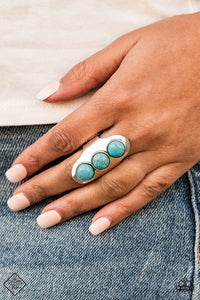 Dotted in a trio of refreshing turquoise stones, an antiqued silver frame folds around the finger for artisanal look. Features a stretchy band for a flexible fit.