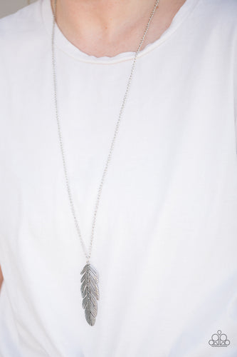 Glittery hematite rhinestones are encrusted down the spine of a life-like silver feather. The whimsical pendant swings from the bottom of a lengthened silver chain for a seasonal look. Features an adjustable clasp closure.  Sold as one individual necklace. Includes one pair of matching earrings.  Always nickel and lead free.