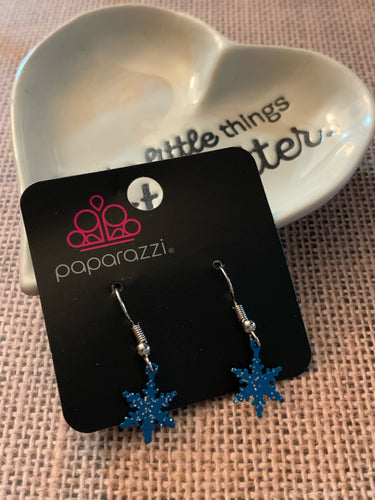 Cute and dainty blue snowflakes swing daintly from the ear.  Earring attaches to a standard fishhook fitting.  Sold as one pair of earrings.  Always nickel and lead free.
