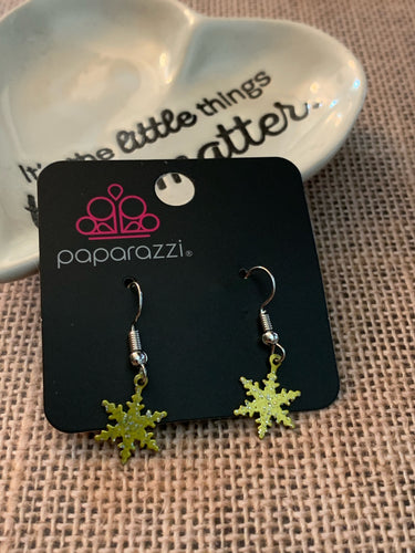 Cute and dainty gold snowflakes swing daintly from the ear.  Earring attaches to a standard fishhook fitting.  Sold as one pair of earrings.  Always nickel and lead free.