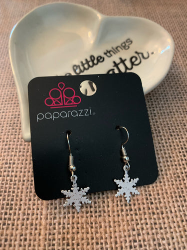 Cute and dainty white snowflakes swing daintily from the ear.  Earring attaches to a standard fishhook fitting.  Sold as one pair of earrings.  Always nickel and lead free.