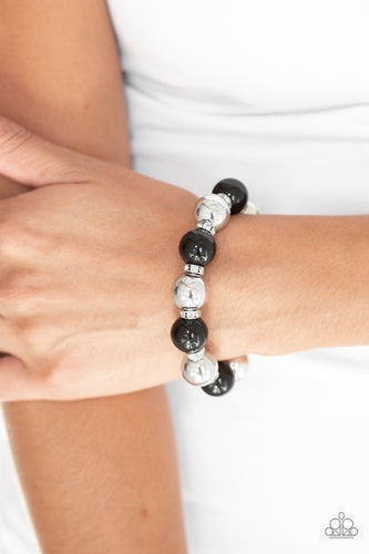 A collection of white rhinestone encrusted rings, shiny black beads, and classic silver beads are threaded along a stretchy band around the wrist for a glamorous look.  Sold as one individual bracelet. Always nickel and lead free.