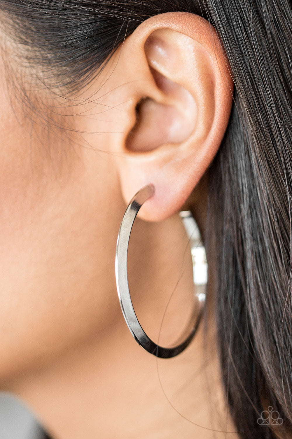 "Brushed in a high-sheen finish, a glistening silver hoop curls into a bold ribbed look for a sassy industrial finish. Earring attaches to a standard post fitting. Hoop measures 1 3/4"" in diameter.  Sold as one pair of hoop earrings.  Always nickel and lead fre"