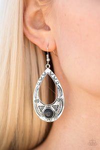 Stamped in tribal inspired patterns, a glistening silver teardrop swings from the ear in a whimsical fashion. A smooth black stone is pressed into the bottom of the frame, adding an earthy flair to the indigenous lure. Earring attaches to a standard fishhook fitting.  Sold as one pair of earrings.  Always nickel and lead free.