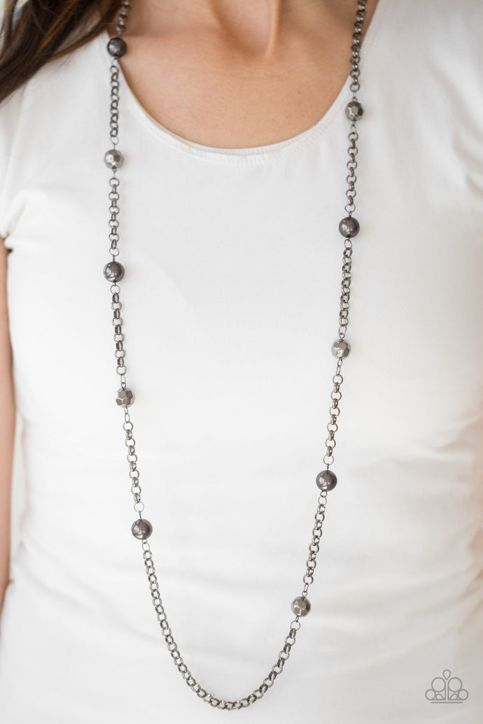 Pearly and faceted gunmetal beads trickle along a bold gunmetal chain, creating a fierce tone on tone palette. Features an adjustable clasp closure.  Sold as one individual necklace. Includes one pair of matching earrings.  Always nickel and lead free.