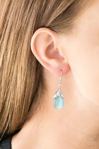 A glowing blue moonstone drips from a shimmery silver fitting embossed in floral detail and radiating with glittery white rhinestones for a seasonal look. Earring attaches to a standard fishhook fitting.  Sold as one pair of earrings.  Always nickel and lead free.