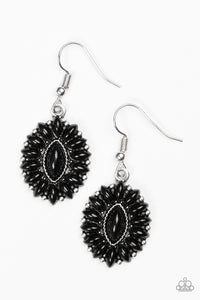 Marquise shaped black beads are pressed into a shimmery silver frame, coalescing into a whimsical lure.