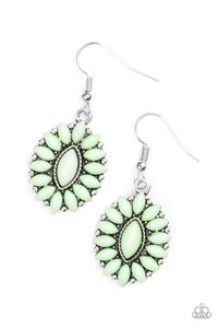Green marquise shaped beads are pressed into a shimmery silver frame, coalescing into a whimsical lure