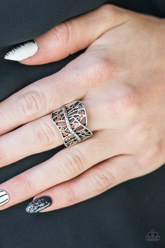 Dainty orange rhinestones are sprinkled along a shattered silver frame, creating an edgy centerpiece atop the finger. Features a stretchy band for a flexible fit.  Sold as one individual ring.   Always nickel and lead free.