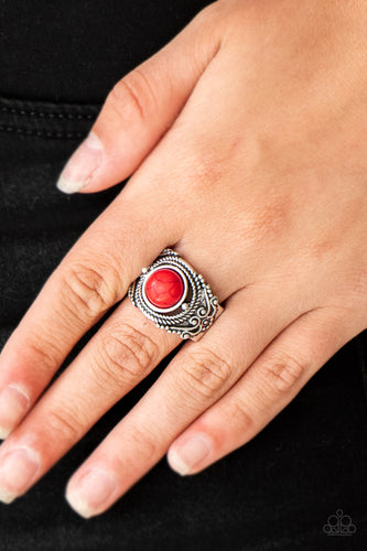 A fiery red stone is pressed into an ornate silver band radiating with rope-like and studded textures for a seasonal look. Features a stretchy band for a flexible fit.  Sold as one individual ring.  Always nickel and lead free.