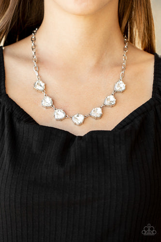 Attached to an oversized silver chain, faceted white teardrop frames delicately connect below the collar for a glamorous look. Features an adjustable clasp closure.  Sold as one individual necklace. Includes one pair of matching earrings.  Always nickel and lead free.