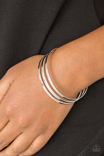 Flat silver bars race across the wrist, coalescing into a sleek cuff for a casual look.  Sold as one individual bracelet.  Always nickel and lead free.
