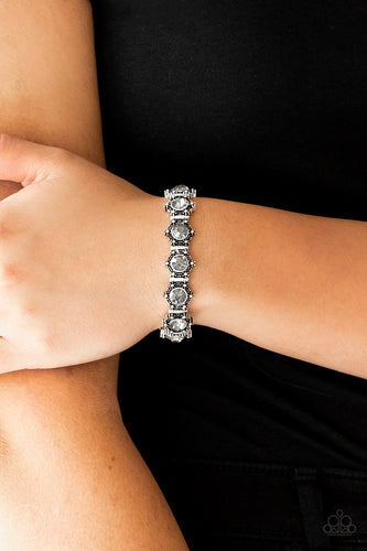 Featuring smoky rhinestone centers, ornate silver frames are threaded along stretchy bands, linking across the wrist for a refined look.  Sold as one individual bracelet  Always nickel and lead free.