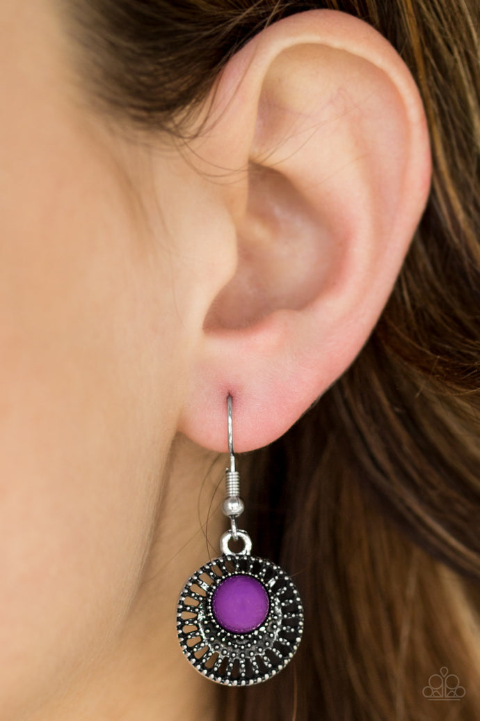 A vivacious purple bead is pressed into an airy silver frame radiating with studded textures for a seasonal look. Earring attaches to a standard fishhook fitting.  Sold as one pair of earrings.  Always nickel and lead free.