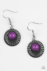 A vivacious purple bead is pressed into an airy silver frame radiating with studded textures.