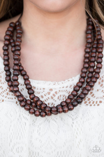 Tinted in a brown finish, wooden beads are threaded along black cording, creating three colorful layers below the collar. Features a button-loop closure.  Sold as one individual necklace. Includes one pair of matching earrings.   Always nickel and lead free.