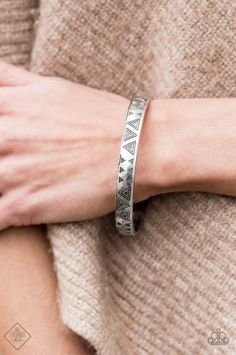 Brushed in an antiqued shimmer, decorative triangular patterns are stamped along a glistening silver bangle for a tribal inspired look.  Sold as one individual bracelet.   Sunset Sightings Fashion Fix   Always nickel and lead free.