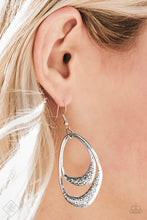Load image into Gallery viewer, Scratched in shimmery textures, two asymmetrical silver hoops swing from the bottom of a silver link, creating a bold artisan inspired lure. Earring attaches to a standard fishhook fitting.  Sold as one pair of earrings.