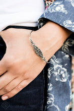 Load image into Gallery viewer, Featuring faceted silver beaded and white rhinestone encrusted centers, rectangular filigree filled silver frames are threaded along a stretchy band around the wrist for a vintage inspired look.