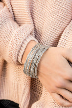 Load image into Gallery viewer, Studded in an array of mismatched patterns, a stack of silver bangles slide up and down the wrist, evoking a wanderlust vibe.  old as one set of five bracelets.