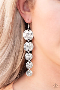 Hammered antiqued silver discs gradually decrease in size as they trickle from the ear, creating a dramatically long lure. Earring attaches to a standard fishhook fitting.