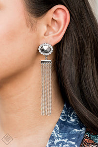 Silver chains stream from the bottom of a faceted silver bead that has been nestled inside a ring of glittery white rhinestones, creating a flirtatious tassel. Earring attaches to a standard post fitting.