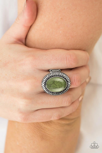 Stamped in tribal inspired patterns, an antiqued silver frame spins around a refreshing green stone for a seasonal finish. Features a stretchy band for a flexible fit.  Sold as one individual ring.  Always nickel and lead free.