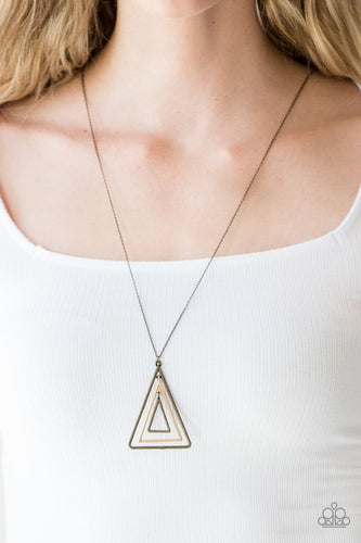Infused with an elongated brass chain, glistening gold and brass triangular frames layer into a gorgeously stacked pendant for an edgy look. Features an adjustable clasp closure.  Sold as one individual necklace. Includes one pair of matching earrings.  Always nickel and lead free.