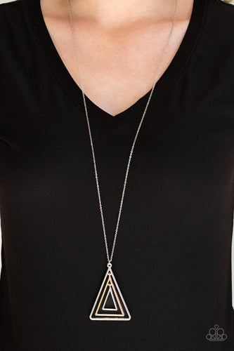 Infused with an elongated silver chain, glistening gold and silver triangular frames layer into a gorgeously stacked pendant for an edgy look. Features an adjustable clasp closure.  Sold as one individual necklace. Includes one pair of matching earrings.  Always nickel and lead free.