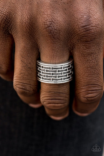 Brushed in an antiqued finish, abstract bar-like patterns are stamped across the front of a thick silver band for a casual look. Features a stretchy band for a flexible fit.  Sold as one individual ring.  Always nickel and lead free.