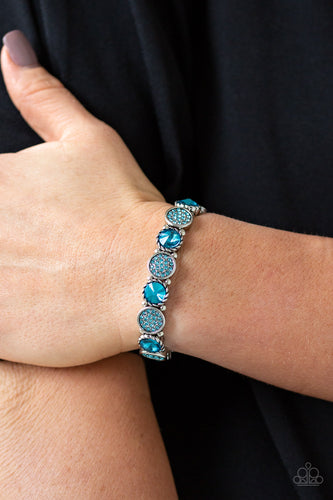 Featuring an array of glittery blue rhinestones, mismatched silver frames and dainty silver beads are threaded along stretchy bands around the wrist for a glamorous flair.  Sold as one individual bracelet.  Always nickel and lead free.