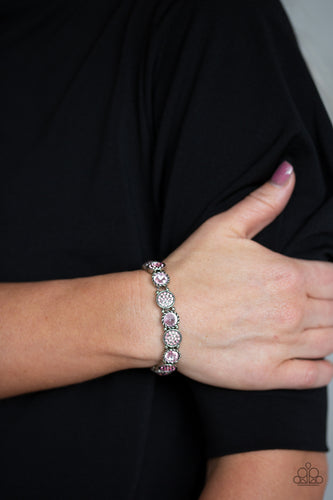 Featuring an array of glittery pink rhinestones, mismatched silver frames and dainty silver beads are threaded along stretchy bands around the wrist for a glamorous flair.  Sold as one individual bracelet.  Always nickel and lead free.