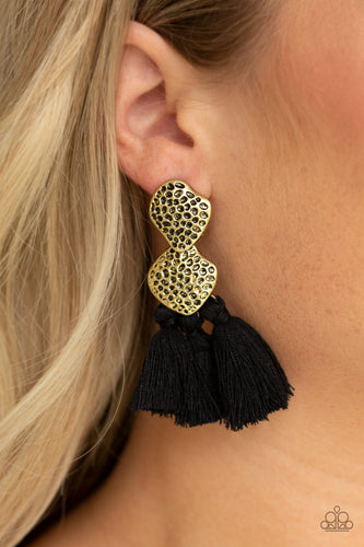 Delicately hammered in glistening textures, two asymmetrical brass frames link into an abstract lure. Three black threaded tassels swing from the bottom of the rustic frame for a trendy finish. Earring attaches to a standard post fitting.  Sold as one pair of post earrings.  Always nickel and lead free.