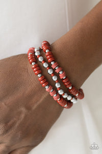 A variety of Chili Oil and dainty silver beads are threaded along stretchy elastic bands, creating colorful layers across the wrist.  Sold as one set of three bracelets.  Always nickel and lead free.