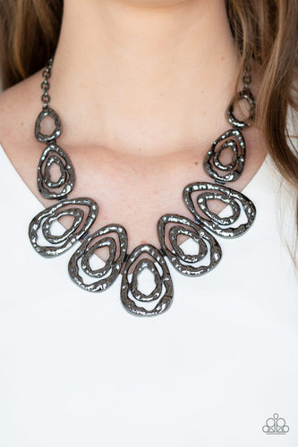 Delicately hammered in blinding shimmer, glistening gunmetal bars spin into asymmetrical teardrops. The airy abstract frames link into a bold industrial statement piece below the collar. Features an adjustable clasp closure.  Sold as one individual necklace. Includes one pair of matching earrings. Always nickel and lead free.