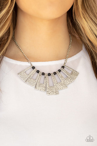 Infused with dainty black stone beads, hammered silver rectangular frames fan out below the collar for a bold seasonal look. Features an adjustable clasp closure.  Sold as one individual necklace. Includes one pair of matching earrings.  Always nickel and lead free.