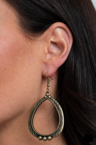 Decorated in metallic rope-like textures, a studded brass teardrop is stamped and etched in tribal inspired patterns for a rustic flair. Earring attaches to a standard fishhook fitting.  Sold as one pair of earrings.  Always nickel and lead free.