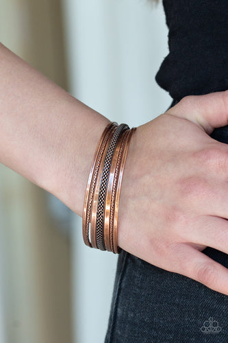 Featuring diamond-cut shimmer, rows of antiqued copper bars arc across the wrist, stacking into a bangle-like cuff.  Sold as one individual bracelet.  Always nickel and lead free.