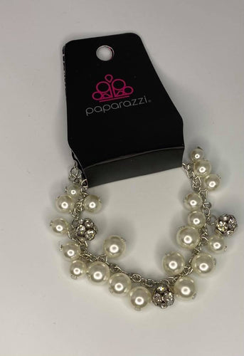 Infused with clusters of dainty white pearls linking around the wrist, creating a bubbly fringe. Features an adjustable clasp closure.  Sold as one individual bracelet.   Always nickel and lead free.  Fashion Fix February 2021 Exclusive