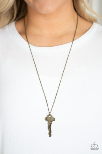 A mismatched pair of brass keys swing from the bottom of a shimmery brass chain, creating an edgy pendant. Features an adjustable clasp closure.  Sold as one individual necklace. Includes one pair of matching earrings.  Always nickel and lead free.