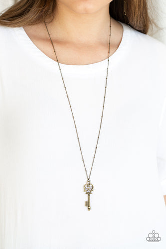 Brushed in an antiqued finish, dainty brass keys swing from the bottom of an elongated brass chain in a vintage inspired fashion. Features an adjustable clasp closure.  Sold as one individual necklace. Includes one pair of matching earrings.  Always nickel and lead free.