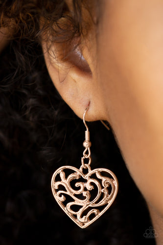 Shiny rose gold filigree climbs an airy heart-shaped frame for a whimsical look. Earring attaches to a standard fishhook fitting.  Sold as one pair of earrings.  Always nickel and lead free.