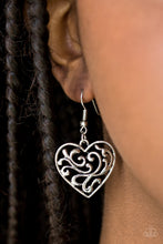 Load image into Gallery viewer, Shiny silver filigree climbs an airy heart-shaped frame for a whimsical look. Earring attaches to a standard fishhook fitting.  Sold as one pair of earrings.  Always nickel and lead free.