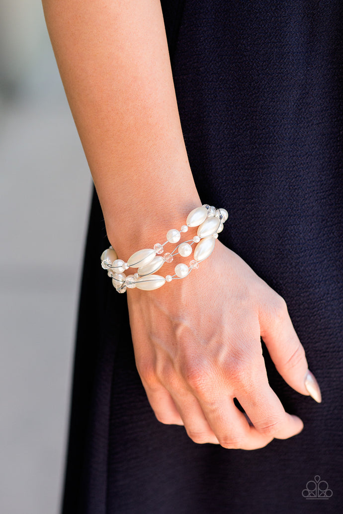 Varying in size and shimmer, pearlescent and crystal-like beading is threaded along rows of shimmery wires, creating floating layers around the wrist. Features an adjustable clasp closure.  Sold as one individual bracelet.  Always nickel and lead free.