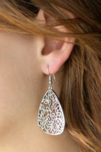 Load image into Gallery viewer, Dotted in texture, leafy silver filigree climbs an asymmetrical silver frame, creating a seasonal lure. Earring attaches to a standard fishhook fitting.  Sold as one pair of earrings.   Always nickel and lead free.