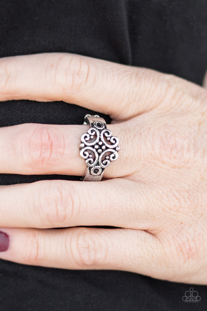 <p>Brushed in an antiqued shimmer, glistening silver ribbons swirl atop the finger, creating whimsical filigree. Features a dainty stretchy band for a flexible fit.<br><br><em>Sold as one individual ring.</em></p> <p><i><strong><em>Always nickel and lead free.</em> </strong></i></p>