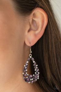 Varying in size and shape, a refined collection of purple and white rhinestones are encrusted along a shimmery silver teardrop frame for a timeless look. Earring attaches to a standard fishhook fitting.  Sold as one pair of earrings.  Always nickel and lead free.