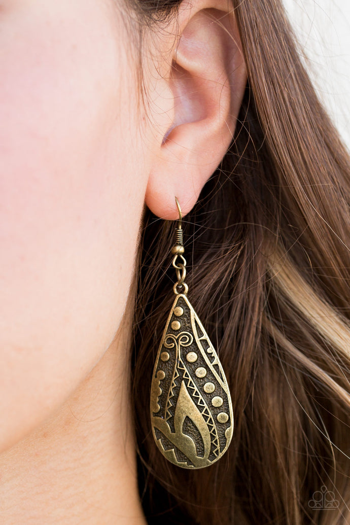 Embossed in tactile textures, a glistening brass teardrop swings from the ear in a seasonal fashion. Earring attaches to a standard fishhook fitting.  Sold as one pair of earrings.  Always nickel and lead free.