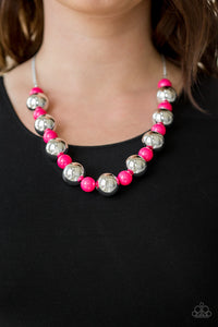 Polished pink beads and dramatic silver beads drape below the collar for a perfect pop of color. Features an adjustable clasp closure.  Sold as one individual necklace. Includes one pair of matching earrings.  Always nickel and lead free.