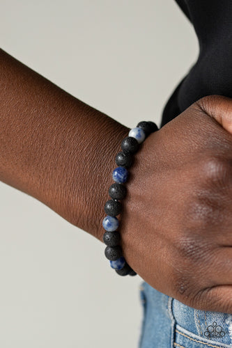ESSENTIAL OIL ALERT!! A collection of black lava rock and tranquil blue stone beads are threaded along a stretchy band around the wrist for a seasonal look.  Sold as one individual bracelet.  Always nickel and lead free.